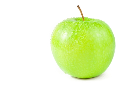green apple with droplets of water isolated on white background photo