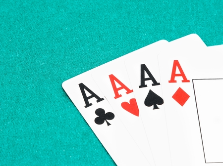 poker aces cards on green table, concept of poker game with space for text photo
