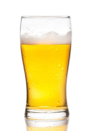 glass of fresh beer with drops on white background, with reflection on table