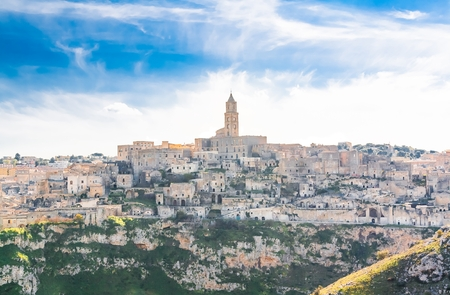 sassi: panoramic view of stones of Matera under blue sky. Basilicata, Italy