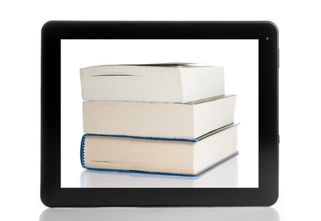 books and tablet pc isolated on white background, digital library concept photo