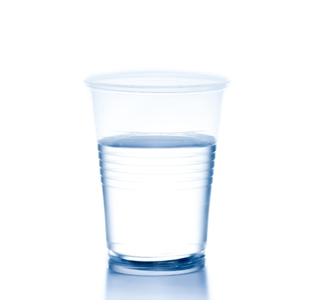 plastic cup with water on white , concept of nutrition and diet photo