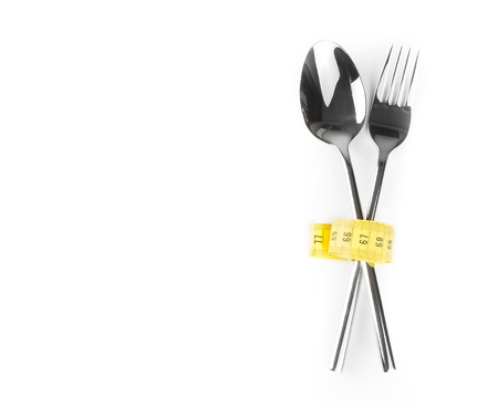 top of view of measuring tape near spoon and fork, concept of nutrition and diet on white with space for text photo