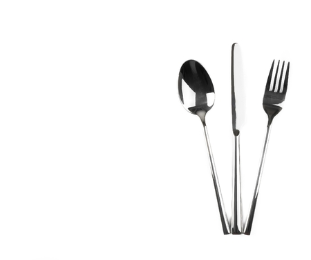 top of view of spoon, knife and fork isolated on white background, with space for text photo