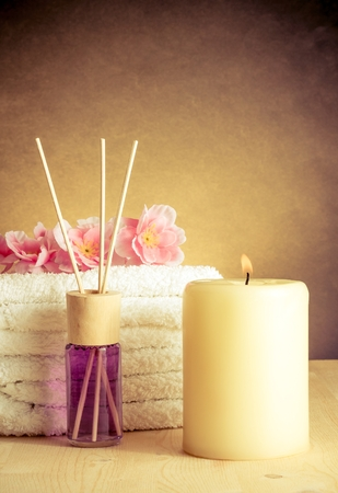 herbal massage ball: Spa massage border background with towel stacked, perfume diffuser, warm atmosphere