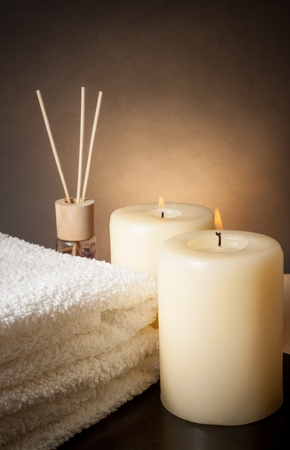 Spa massage border background with towel stacked and candles, with space for text