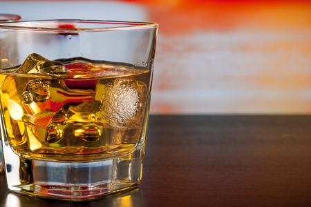 whiskey with ice on bar table lounge bar atmosphere with space for text photo