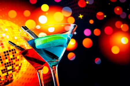 blue and red cocktail with sparkling disco ball background with space for text, dance disco concept photo