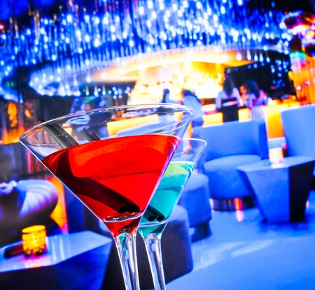 lounge bar: blue and red cocktail drink with space for text, lounge bar background