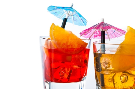 detail of two cocktail with orange slice and umbrella on top isolated on white background with space for text photo