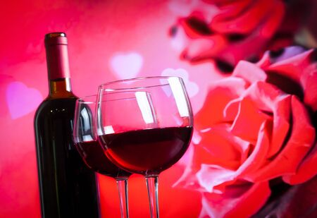 two red wine glasses on blur red roses background, festive and love concept photo