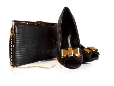 woman handle success: Black female leather bag and velvet shoes isolated over white background with golden detail