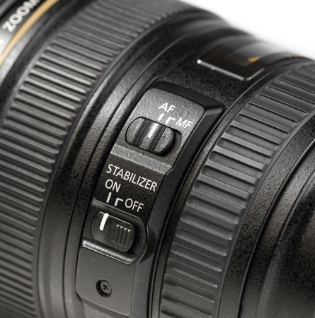 close up stabilizer button on camera lens Stock Photo