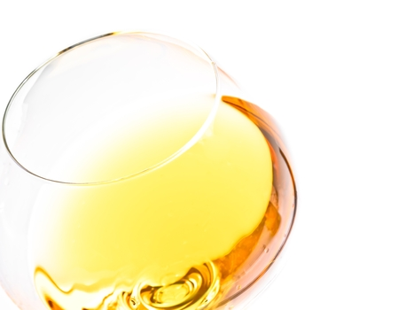 top of view of white wine glass isolated with space for text on white background photo