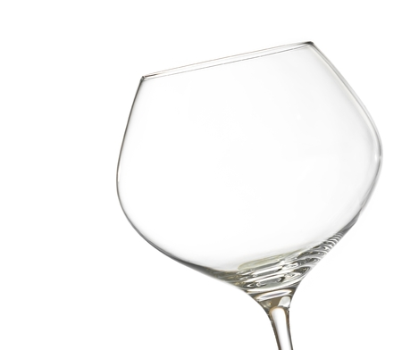 empty white wine into a glass on white background with space for text photo