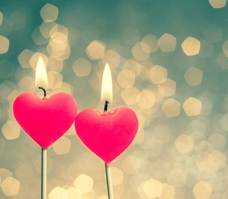 good color: hearts candles on vintage bokeh as background vintage style, valentine day and love concept