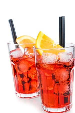two glasses of spritz aperitif aperol cocktail with orange slices and ice cubes isolated on white background with space for text