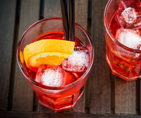 spritz: spritz aperitif aperol cocktail with orange slices and ice cubes on wood table Stock Photo