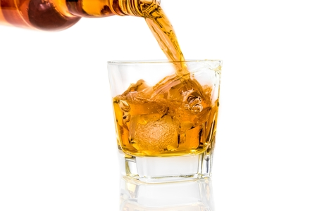 barman: barman pouring whiskey on white background with reflection