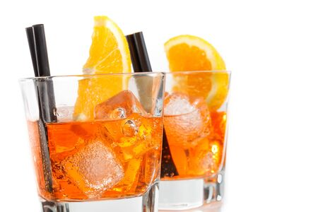 spritz: two glasses of spritz aperitif aperol cocktail with orange slices and ice cubes isolated on white background Stock Photo