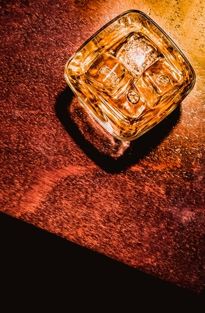 liquor glass: top of view of glass of whiskey on wood table artistic style, warm atmosphere, time of relax with whisky with space for text