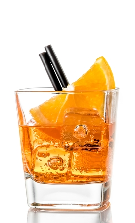 glass of spritz aperitif aperol cocktail with orange slices and ice cubes isolated on white background