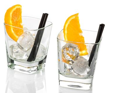 spritz: empty glasses of spritz aperitif aperol cocktail with orange slices and ice cubes isolated on white background