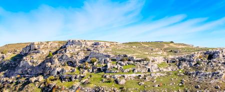 palaeolithic: Landscape of rupestrian church. Sassi of Matera. Basilicata under blue sky