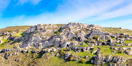 palaeolithic: Landscape of rupestrian church, historic building. Sassi of Matera. Basilicata under blue sky