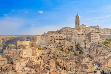 sassi: panoramic view of typical stones (Sassi di Matera) and church of Matera UNESCO European Capital of Culture 2019 under blue sky. Basilicata, Italy