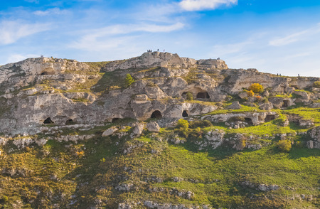 rupestrian: Landscape of rupestrian house and church, historic building. Sassi of Matera. Basilicata under blue sky
