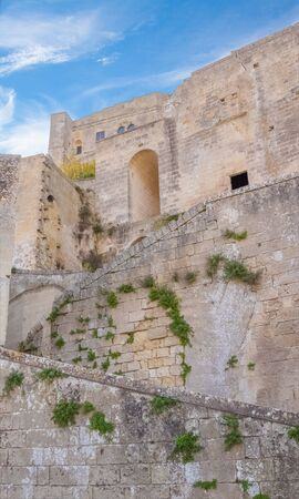 european culture: historic building in Matera in Italy UNESCO European Capital of Culture 2019, details of old wall and stairs Stock Photo