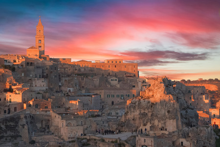 sassi: panoramic view of typical stones and church of Matera and the Madonna de Idris under sunset sky. Basilicata, Italy Stock Photo