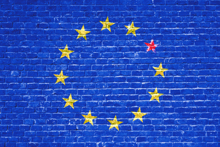 skepticism: brexit blue european union EU flag on brick wall and one star with great britain flag, vote for united kingdom exit concept