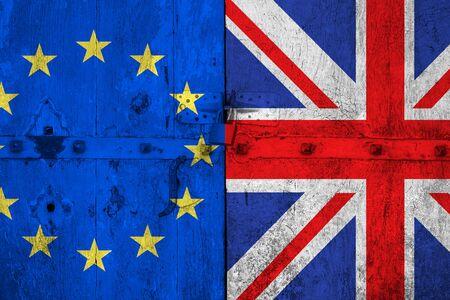 skepticism: brexit blue european union EU flag and half great britain flag on old wood door, vote for referendum united kingdom exit concept Stock Photo