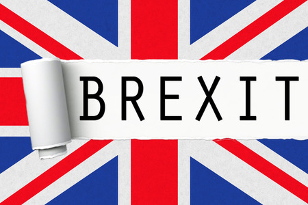 skepticism: uk england great britain flag with word brexit on ripped torn paper, vote for referendum united kingdom exit concept