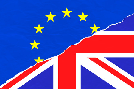 skepticism: brexit half blue european union EU flag and half uk england great britain flag on ripped torn paper, vote for referendum united kingdom exit concept Stock Photo