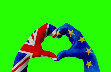 skepticism: brexit, hands of man in heart shape patterned with the flag of blue european union EU and flag of great britain uk on chroma key green screen background, vote referendum for united kingdom exit concept