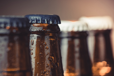 wallop: close-up of fresh cold beer ale bottles with drops