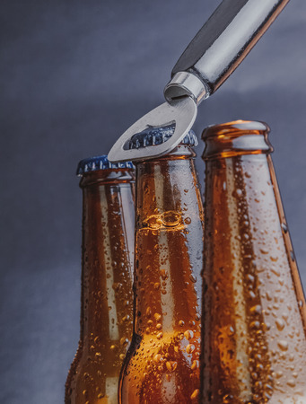 wallop: man open fresh cold beer ale bottles with drops