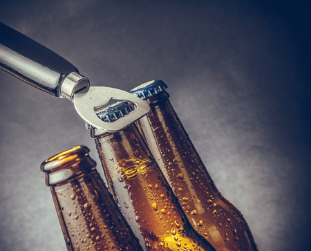 wallop: three fresh cold beer ale bottles with drops Stock Photo