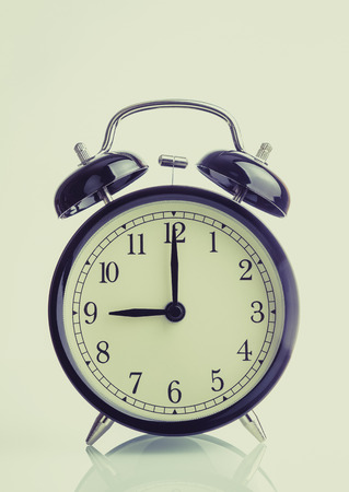 its nine oclock already, time to wake up for breakfast, vintage old black metallic alarm clock isolated white background 版權商用圖片