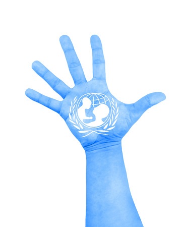 ROME, Italy - December 9, 2015: open hand raised with color blue and white of flag of unicef painted on white background 스톡 콘텐츠
