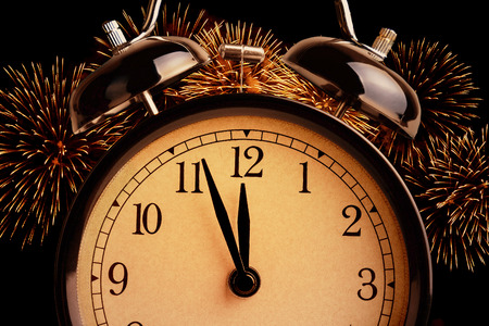 midnight: vintage alarm clock is showing midnight.