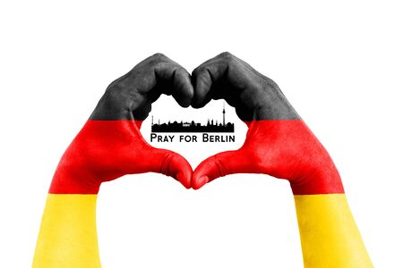 pray for berlin, germany, city silhouette inside man hands in the form of heart with the flag of germany on the white background, concept for hope and helpful support for the berlin victims