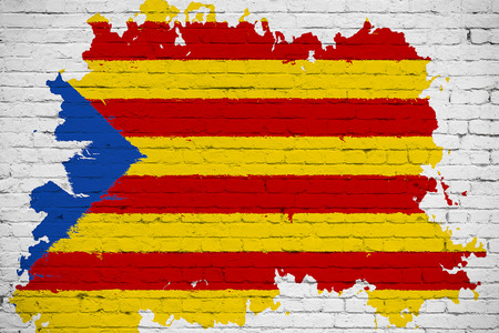 flag of catalonia yellow, red stripe and star with watercolor splash effect on white brick wall background, national catalan symbol vote for separatism independence from spain concept