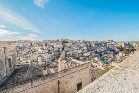 panoramic view of typical stones (Sassi di Matera) near gravina of Matera UNESCO European Capital of Culture 2019 on blue sky. Basilicata, Italy