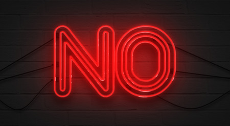 attract attention: flickering blinking red neon sign on brick wall background, no negation symbol concept Stock Photo