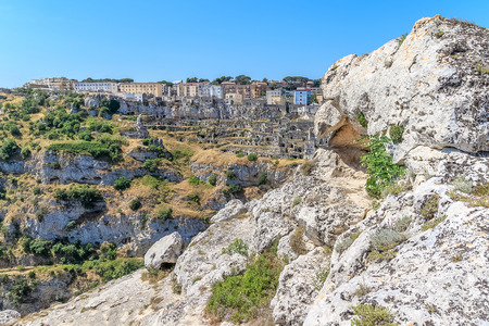 panoramic view of typical stones house (Sassi di Matera) of Matera UNESCO European Capital of Culture 2019 under blue sky. Basilicata, Italy Stock Photo