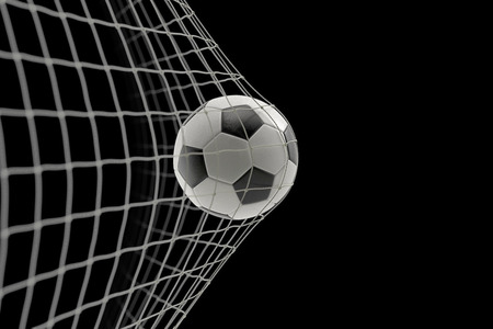 soccer ball in goal on black background, concept of competition and leisure game equipment Standard-Bild - 107784308